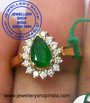 Emerald Ring Designs with Diamonds in Gold for Ladies