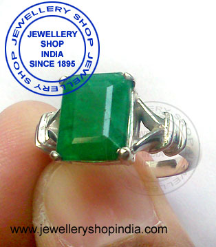 Emerald Gemstone Ring Designs with diamonds for ladies