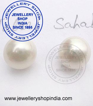 Natural pearl earring designs in gold for ladies.